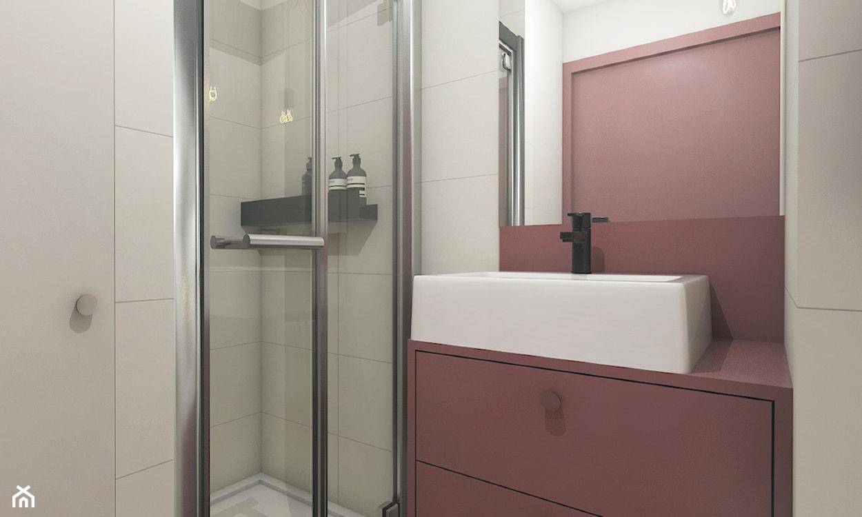 mała łazienka z różowymi akcentami