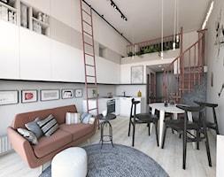 MINImum powierzchni, MAXImum funkcjonalności - Mały szary biały salon z bibiloteczką z kuchnią z jadalnią z antresolą - zdjęcie od Projekt MIMO