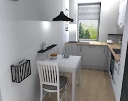 Mieszkanie (Kraków) - Mała otwarta wąska biała kuchnia w kształcie litery l z oknem, styl skandynawski - zdjęcie od Agnieszka Buchta-Swoboda Design