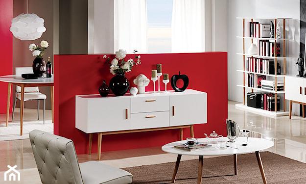 białe meble i czerwona ściana