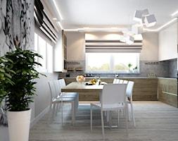 Kuchnia z pazurem - Duża biała beżowa kuchnia w kształcie litery l z oknem, styl nowoczesny - zdjęcie od DemoDesign Jacek Staniszewski Studio projektowania wnętrz - Homebook