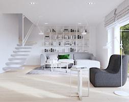 Jasny, biały salon i bardzo oryginalna poręcz schodów. - zdjęcie od SARNA ARCHITEKCI / Architektura Wnętrza dla wymagających / Interior Design - Homebook