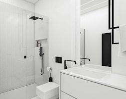 Łazienka: biel i akcenty czarne. Doskonała, czysta forma wnętrza - zdjęcie od SARNA ARCHITEKCI / Architektura Wnętrza dla wymagających / Interior Design - Homebook