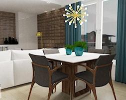 Salon z aneksem kuchennym Koszalin - Mała otwarta biała jadalnia w salonie - zdjęcie od DOBRY UKŁAD-Sandra Białkowska