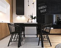 Ciepłe mieszkanie w nowoczesnym stylu - Średnia otwarta jadalnia w kuchni w salonie, styl nowoczesny - zdjęcie od Ambience. Interior design