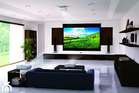 Stwórz kino we własnym domu. Dlaczego warto wybrać projektor?