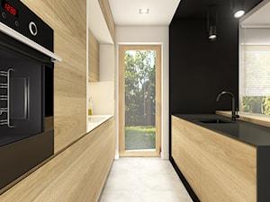 Dom pod Wolbromiem - Średnia zamknięta wąska biała czarna kuchnia dwurzędowa, styl minimalistyczny - zdjęcie od WERDHOME
