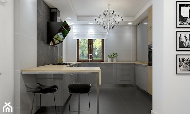 szare szafki w małej kuchni