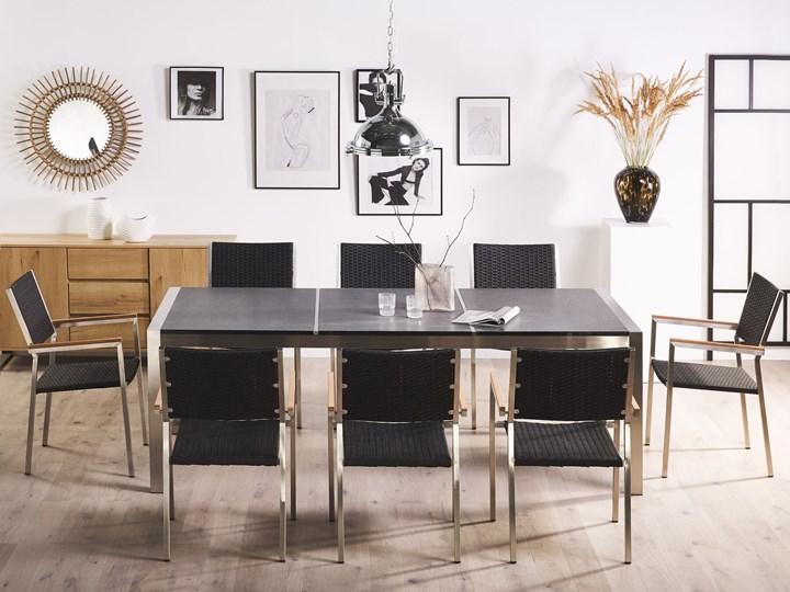 Zestaw mebli ogrodowych jadalniany szary stół granit/bazalt 220 x 100 cm 8 czarnych krzeseł z technorattanu sztaplowanych Stal Stoły z krzesłami Zawartość zestawu Krzesła