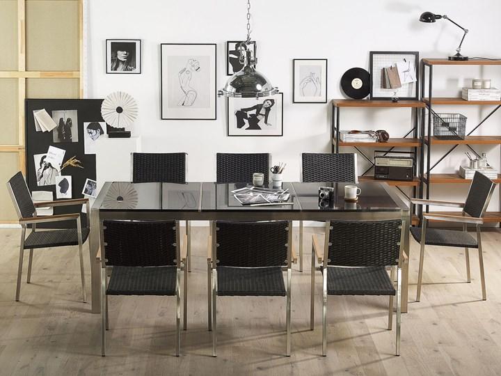 Zestaw mebli ogrodowych jadalniany czarny stół granit/bazalt 220 x 100 cm 8 krzeseł z technorattanu sztaplowanych Styl Nowoczesny Stoły z krzesłami Stal Kategoria Zestawy mebli ogrodowych