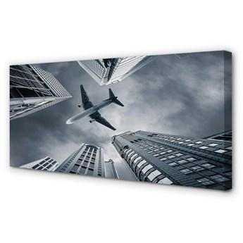 Obraz na płótnie Miasto chmury samolot niebo