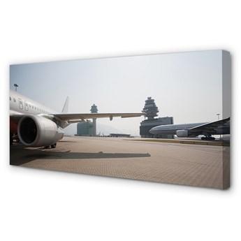 Obraz na płótnie Samolot budynki lotnisko niebo