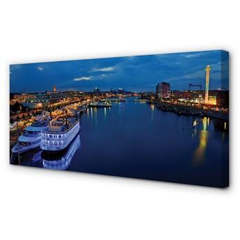 Obrazy na płótnie Statek morze miasto nocą niebo