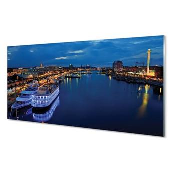 Obrazy na szkle Statek morze miasto nocą niebo