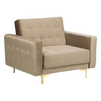 Fotel rozkładany beżowy welurowy pikowany nowoczesny styl złote nogi