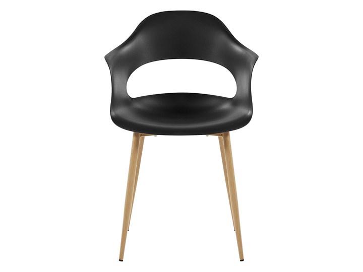 Zestaw 2 krzeseł czarnych plastikowych nóżki jasne drewno ozdobne do jadalni styl skandynawski Metal Wysokość 81 cm Szerokość 54 cm Głębokość 47 cm Tworzywo sztuczne Pomieszczenie Jadalnia