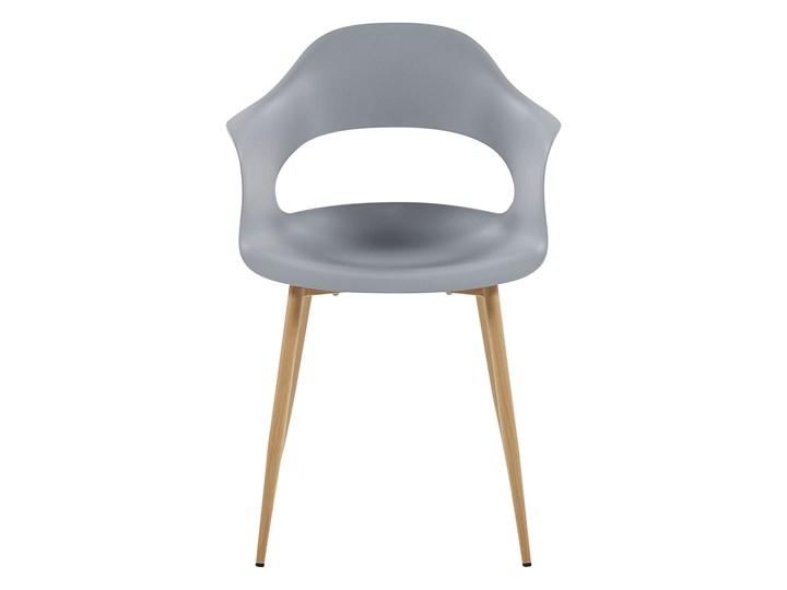Zestaw 2 krzeseł szarych plastikowych nóżki jasne drewno ozdobne do jadalni styl skandynawski Styl Nowoczesny Szerokość 54 cm Głębokość 47 cm Tworzywo sztuczne Wysokość 81 cm Metal Pomieszczenie Salon