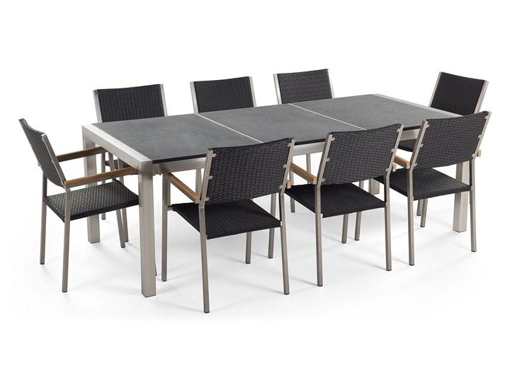 Zestaw mebli ogrodowych jadalniany szary stół granit/bazalt 220 x 100 cm 8 czarnych krzeseł z technorattanu sztaplowanych