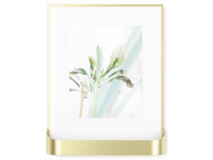 Ramka na zdjęcia z półką Matinee 31x39 cm złota Tworzywo sztuczne Kolor Złoty Kategoria Ramy i ramki na zdjęcia