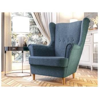 Pikowany skandynawski fotel na drewnianych nogach typu uszak - w kolorze niebieskiego melanżu