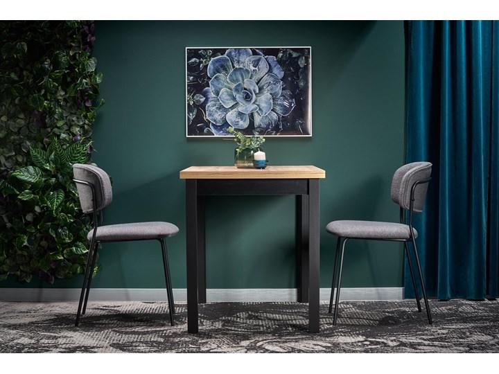 Nierozkładany stół w stylu industrialnym Cobalt Szerokość 120 cm Kształt blatu Prostokątny Długość 120 cm  Metal Drewno Wysokość 77 cm Wysokość 120 cm Rozkładanie