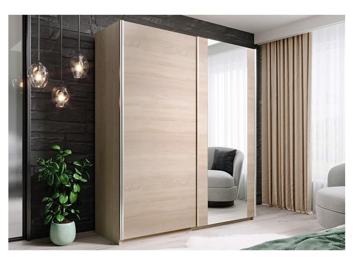Szafa HIT 150 : Dodaj półki: - 3 półki- białe, Wybierz kolor frontu: - sonoma/lustro, Wybierz kolor korpusu: - dąb sonoma Ilość drzwi Dwudrzwiowe Drewno Kategoria Szafy do garderoby