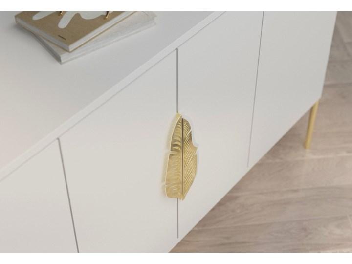 Biała komoda Skandica MERLIN ze złotymi dodatkami Płyta MDF Głębokość 40 cm Wysokość 79 cm Szerokość 138 cm Kolor Biały