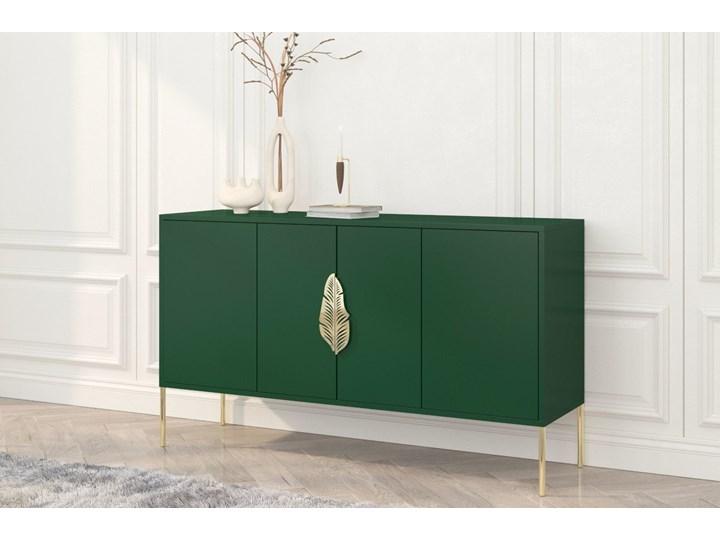Zielona komoda Skandica MERLIN ze złotymi dodatkami Szerokość 138 cm Płyta MDF Głębokość 40 cm Wysokość 79 cm Styl Minimalistyczny