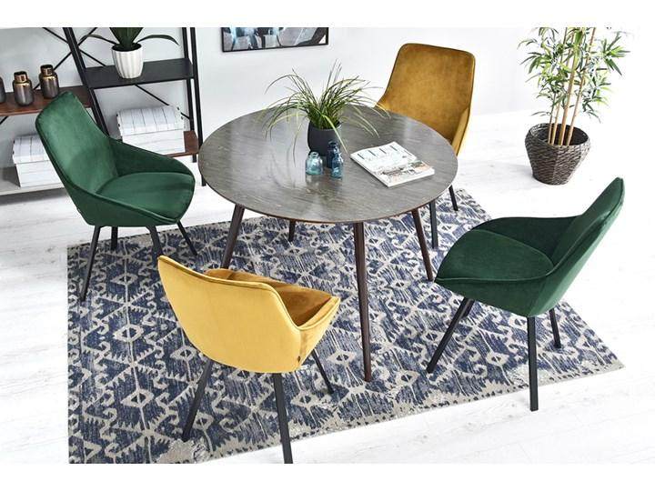 SELSEY Krzesło tapicerowane Yanii z podłokietnikami zielone na czarnej podstawie Kolor Czarny Krzesło inspirowane Metal Tkanina Z podłokietnikiem Pomieszczenie Biuro i pracownia