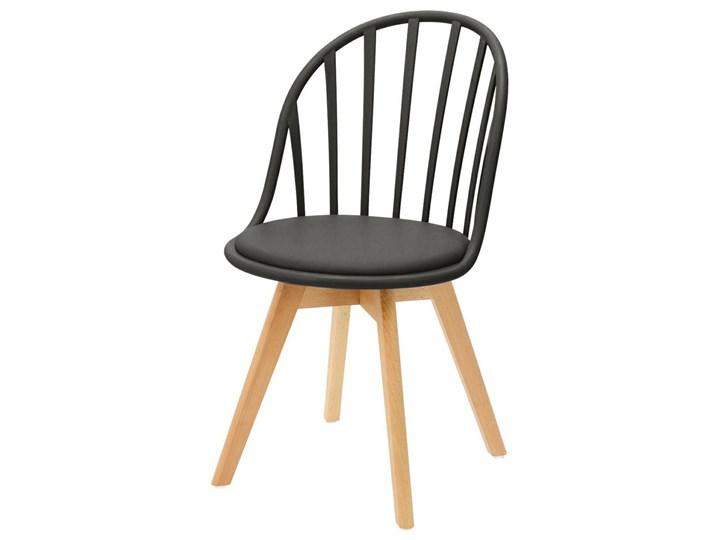 SELSEY Krzesło Taddeus czarne z siedziskiem z ekoskóry na drewnianych nogach Szerokość 58 cm Tworzywo sztuczne Skóra ekologiczna Tradycyjne Wysokość 84 cm Głębokość 57 cm Drewno Pomieszczenie Jadalnia