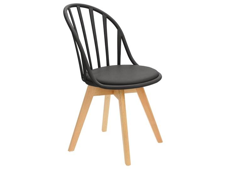 SELSEY Krzesło Taddeus czarne z siedziskiem z ekoskóry na drewnianych nogach Skóra ekologiczna Tradycyjne Styl Nowoczesny Głębokość 57 cm Szerokość 58 cm Tworzywo sztuczne Drewno Wysokość 84 cm Pomieszczenie Jadalnia