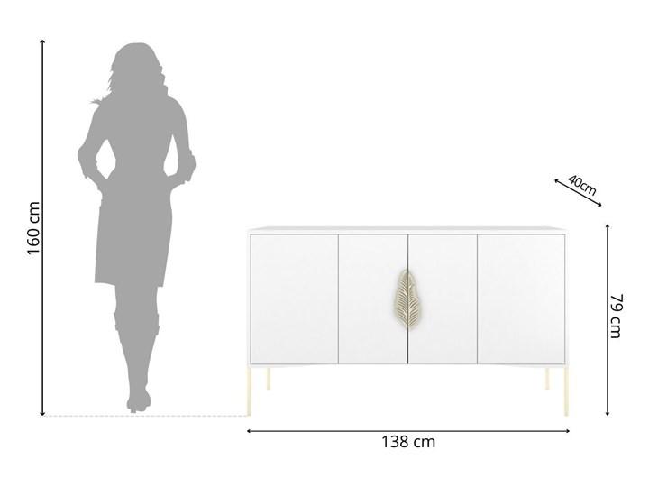 Biała komoda Skandica MERLIN ze złotymi dodatkami Płyta MDF Szerokość 138 cm Wysokość 79 cm Głębokość 40 cm Kolor Biały