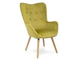 Fotel uszak z weluru na drewnianych bukowych nogach skandynawski do salonu musztardowy F100M