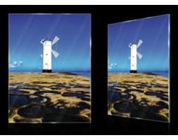 Obraz na szkle Wiatrak na skalistym wybrzeżu GT20067