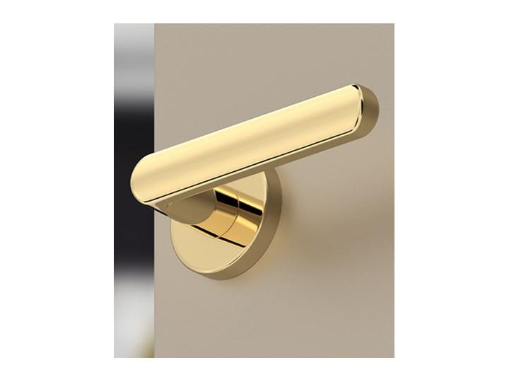 Złota, mosiężna klamka ICONA R renomowanej marki CORONA, do drzwi wewnętrznych