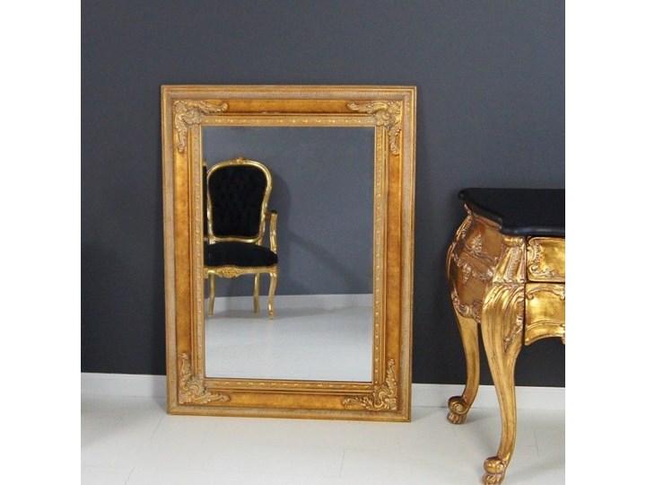 Lustro, drewniana rama, ornamenty, kolor złoty.