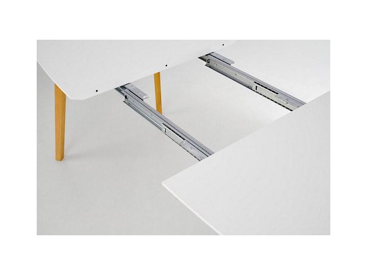 Minimalistyczny stół Modeo - drewniany Drewno Kolor Beżowy Długość 135 cm Wysokość 76 cm Styl Skandynawski