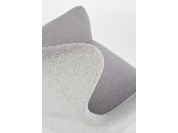 Fotel Cotto - 5 kolorów Jasny popiel Tkanina Wysokość 43 cm Styl Klasyczny Fotel uszak Wysokość 99 cm Szerokość 73 cm Głębokość 76 cm Drewno Pomieszczenie Biuro i pracownia