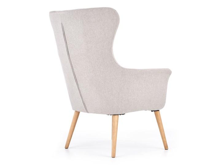 Fotel Cotto - 5 kolorów Jasny popiel Tkanina Fotel uszak Wysokość 43 cm Szerokość 73 cm Wysokość 99 cm Pomieszczenie Biuro i pracownia Głębokość 76 cm Drewno Kolor Szary