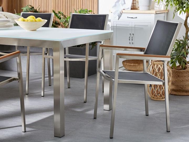 Zestaw mebli ogrodowych jadalniany czarny palony stół granit/bazalt 180 x 90 cm 6 krzeseł tekstylnych sztaplowanych Stoły z krzesłami Stal Tworzywo sztuczne Zawartość zestawu Krzesła