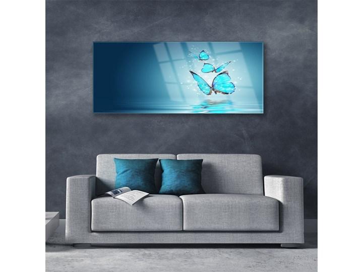 Obraz Szklany Niebieski Motyle Woda Sztuka Wymiary 50x100 cm